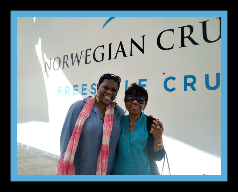 Debbie and Rita posing in front of cruise ship